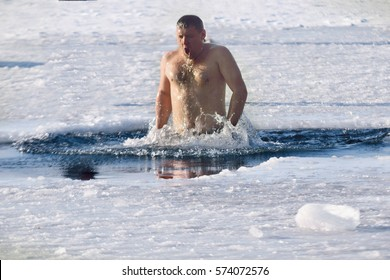 19.01.20017 Russia Nakhodka  man swimming in the winter lake in the ice hole