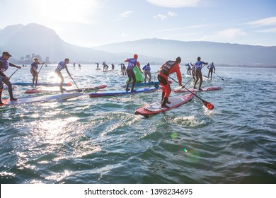19.01.2019 - France Lake Annecy GlaGla Race 2019. SUP racers are participating in sport event. Lake Annecy in Franch Alps. Sunny winter day. excitement and rivalry