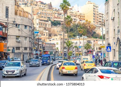 19/02/2019 Amman, Jordan, dirty streets of the Arab capital with a lot of people and cars on a sunny day in Ramadan, jordan - image