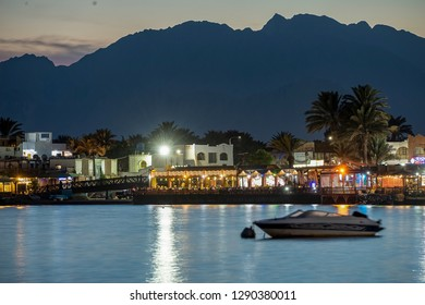 19/11/2018 Dahab, Egypt, incredibly beautiful sunset over a quiet bay in a beautiful spa town with a boat on the foreground