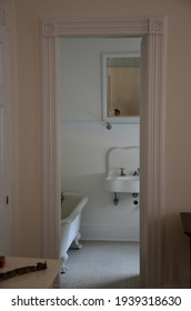 1915 bathroom with sink and tub