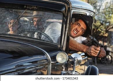 1920s gangster shooting gun from car window