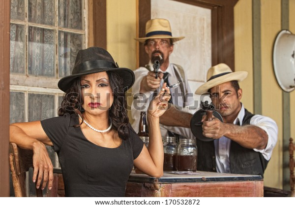 1920s pretty woman with bootleggers and guns