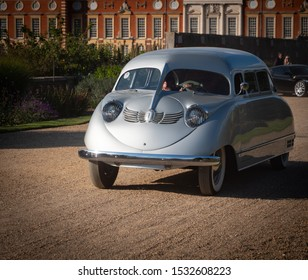 1936 Stout Scarab minivan driving at a concours car show - East Molesey, London/UK - 08-09-2019