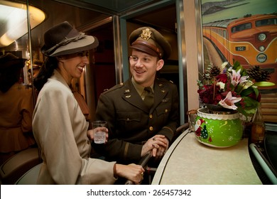 1940's Army reenactor flirts with woman at bar on Pearl Harbor Day Troop train reenactment from Los Angeles Union Station to San Diego