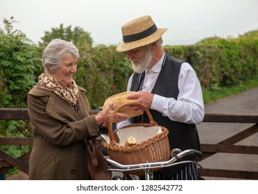 1940s delivery man and elderly house wife