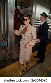 1940's female reenactor departs train on Pearl Harbor Day Troop train reenactment from Los Angeles Union Station to San Diego