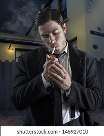1940's style gangster lights a cigarette