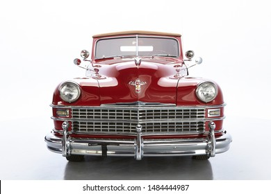 1946 Chrysler Town & Country Roadster. Front shot of a classic american vintage car. Isolated. Chrome bumper and grill