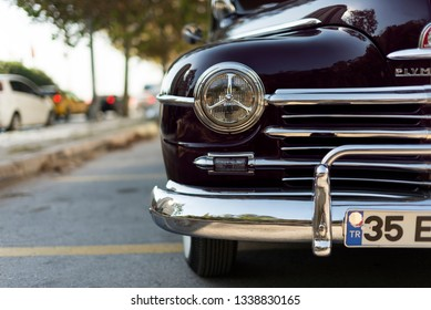 1948; Plymouth; Plymouth Car; Black Color; car; Deluxe; motorized vehicle; front side; 48; front; bumper; head lights; head light; headlight; head; restore; reflection; illustrative; editorial; style;