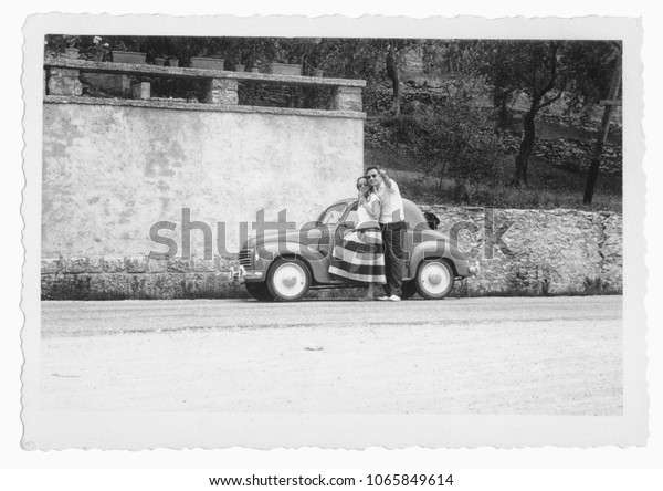 1950. Happy young couple and car