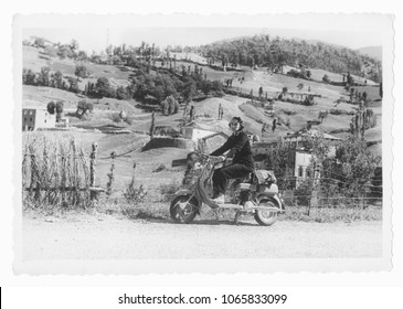 1950 Young woman on motorcycle in Tuscany