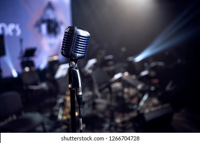 1950s microphone and a band equipment on the stage