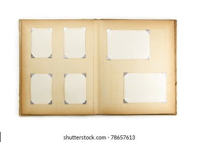 1950s photo album, opened with six pictures, isolated on white.