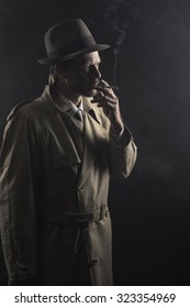 1950s style agent smoking a cigarette at night and looking away, film noir