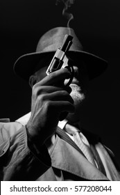 1950s style detective posing in the dark, he is holding a weapon and wearing a fedora hat, noir film character