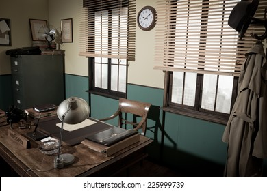 1950s style office with director's desk, vintage phone, file cabinet and other retro items, urban panorama outside.