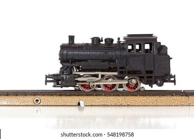 1950s vintage model steam locomotive on the rails