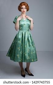 1950's woman in green satin dress