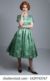 1950's woman in green satin dress