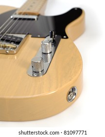 1950s-Style Vintage American Guitar. Photograph of a classic 1950s-style vintage American electric guitar with blonde finish, black pick guard, maple fretboard.