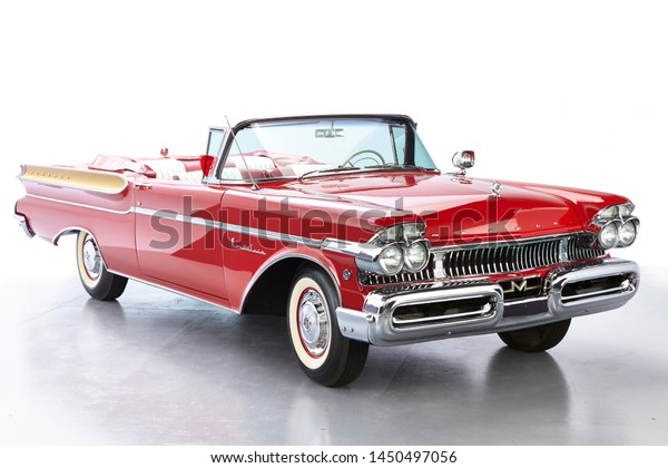 1957 Mercury Montclair Convertible isolated. Classic car once owned by Dick Clarke. Chrome whitewalls and giant fins on this vintage car