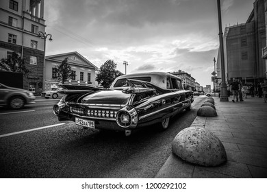 1959 Cadillac Fleetwood at the city street. Back view. Black and white. June 23, 2018, Moscow, Russia.
