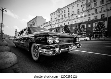 1959 Cadillac Fleetwood at the city street. Front view. Black and white. June 23, 2018, Moscow, Russia.