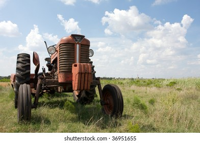 1960s tractor in a country field with logos removed