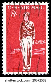 1963 Amelia Earhart Airmail postage Stamp canceled 8c red isolated on black