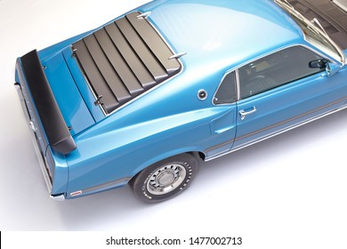 1969 Ford Mustang Mach 1 rear louvers.  blue vintage mustang rear window, overhead.