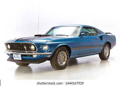 1969 Mach1 Ford Mustang in blue. fastback shutters and rear spoiler. isolated