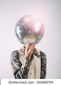 1970s Disco man in leisure suit with a glittering disco mirror ball for a head