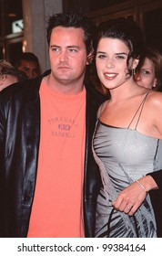 "19OCT99:  ""Friends"" star MATTHEW PERRY & actress NEVE CAMPBELL at Los Angeles premiere of ""Three to Tango"" in which they star with Dylan McDermott.  Paul Smith / Featureflash"
