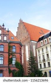 19-th century historical buildings with Roman Catholic Church of St. Dorothea in the background in Wroclaw, Poland.