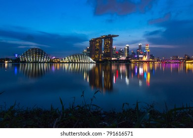 19th Nov. 2016, Singapore, sunset with Marina Bay Sands with reflection in the water.