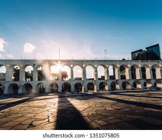 19th-century colonial Lapa Arches, Rio de Janeiro, Brazil - backlit with sun rays coming through one of the openings