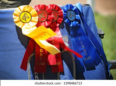 1st, 2nd and 3rd place horse show ribbons blowing in wind