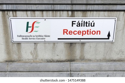 1st August 2019, Drogheda, County Louth, Ireland. HSE Reception entrance wall sign in English and Irish language.