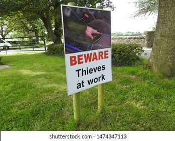 1st August 2019, Drogheda, Ireland. A 'Beware Thieves At Work' sign outside the historic ruins of Monasterboice, an early Christian settlement near Drogheda in County Louth, Ireland.