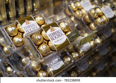1st January 2018,Kuala Lumpur Malaysia.Ferrero Rocher chocolate in plastic box on market shelf.Ferrero Rocher on the supermarket shelf. Ferrero Rocher is a chocolate sweet made by Italian Ferrero Spa.