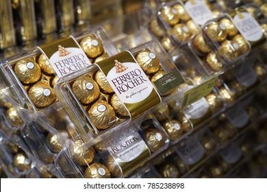 1st January 2018,Kuala Lumpur Malaysia.Ferrero Rocher chocolate in plastic box on market shelf.Ferrero Rocher on the supermarket shelf. Ferrero Rocher is a chocolate sweet made by Italian Ferrero Spa.