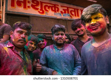 1st March 2018 Vrindavan India : Indian men standind and smiling in front of Banke Bihari temple with color powder on face and body during holi festival in Vrindavan state of Uttar Pradesh in India
