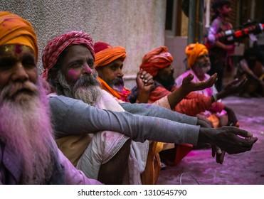 1st March 2018 Vrindavan India : indian holy hermit sitting on street of Vrindavan state of Uttar Pradesh during holi festival in India