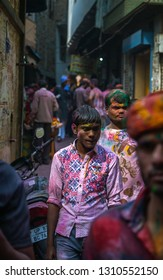 1st March 2018 Vrindavan India : indian hinduism people walking on alleyway of Vrindavan city in Uttar Pradesh state India with color powder and water on face and cloths during holi festival in India