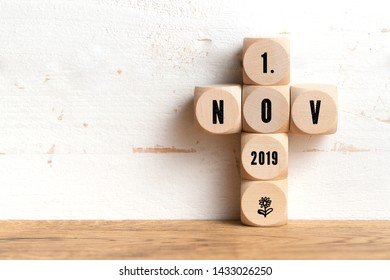 1st November 2019 date on wooden blocks formed as a cross on a table with copy space on a wall depicting the new Brexit deadline or All Saints Day in Catholicism