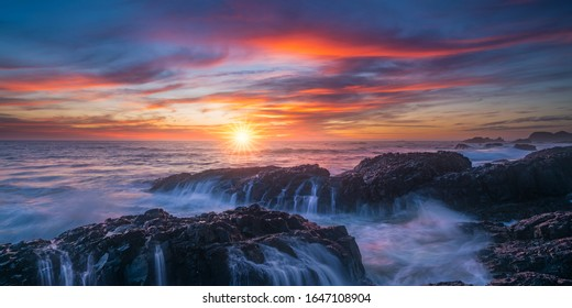 A 2 to 1 ratio panoramic photo of Beluga rock sunset with beautiful clouds and ocean waterfalls