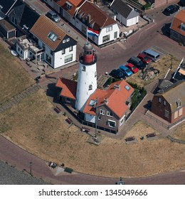 2 August 2018, Urk, The Netherlands. Aerial view of the lighthouse in Urk, an old fishermans town in Flevoland, Holland. It is located in a residential area on the dike at lake IJsselmeer.