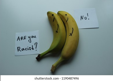 2 Bananas on white background. Cards with text : Are you racist ? No !