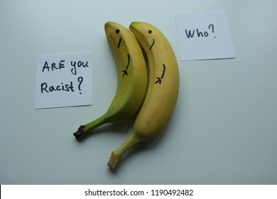 2 Bananas on white background. Cards with text : Are you Racist ? Who ?